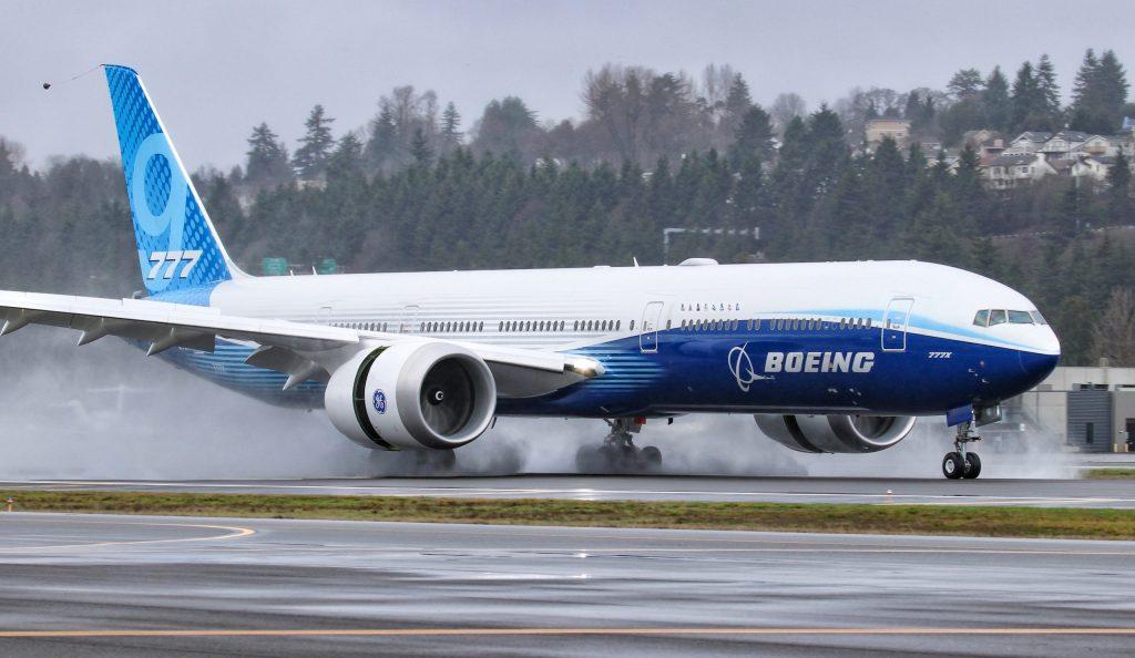 Boeing 777x landing on a wet runway