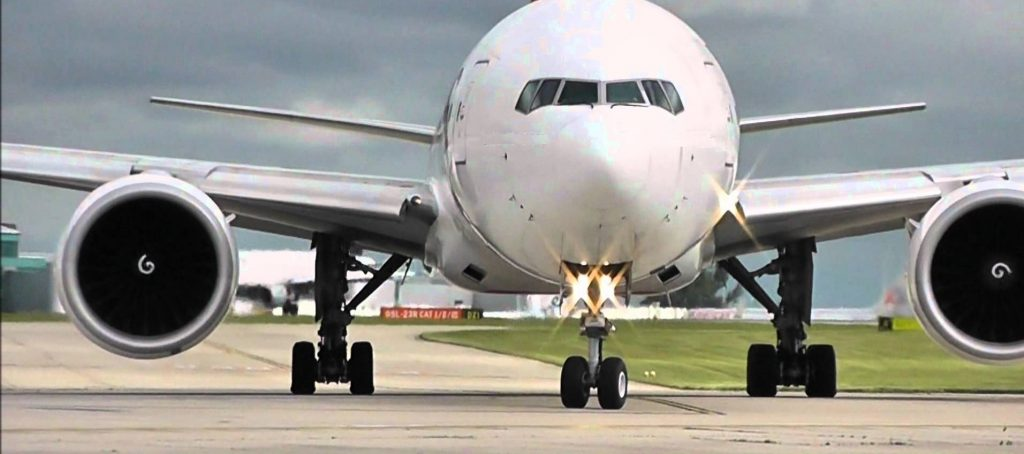 boeing 777 in white taxi on runway