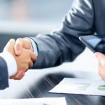 hand shake agree to deliver project performance